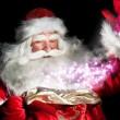 Santa Claus at home at night making magic — Stock Photo