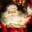 Santa Claus at home at night making magic — Stock Photo #13251192