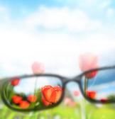 Reading eyeglasses and beautiful nature view. Sight care concept — Стоковое фото