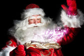 Santa Claus at home at night making magic — Zdjęcie stockowe