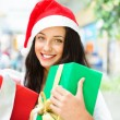 Portrait of young pretty woman wearing Santa Claus helper hat st — Stock Photo #13623058