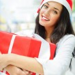 Portrait of young pretty woman wearing Santa Claus helper hat st — Stock Photo