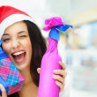 Portrait of young pretty woman wearing Santa Claus helper hat st — Stock Photo #13623065