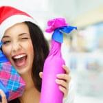 Portrait of young pretty woman wearing Santa Claus helper hat st — Stock Photo