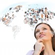 Young woman looking at worldmap with profile photos of her frien — Stock Photo #13623074
