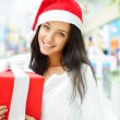 Portrait of young pretty woman wearing Santa Claus helper hat — Stock Photo #13623212