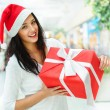 Portrait of young pretty woman wearing Santa Claus helper hat - Stockfoto