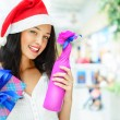 Portrait of young pretty woman wearing Santa Claus helper hat — Stock Photo #13623221