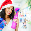 Portrait of young pretty woman wearing Santa Claus helper hat — Stock Photo