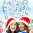 Young happy girls in Christmas hats. Standing together indoors, — Stock Photo