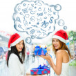 Young happy girls in Christmas hats.Standing together indoors, — Foto Stock