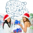 Young happy girls in Christmas hats.Standing together indoors, — Stockfoto