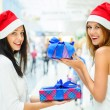 Young happy girls in Christmas hats.Standing together indoors, — Stock Photo #13623262