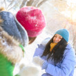 Two happy young girls having fun in winter park and playing snow — Stock Photo