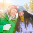 Two happy young girls having fun in winter park and chatting — Stock Photo