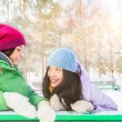 Two happy young girls having fun in winter park — Stock Photo #13623294