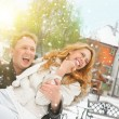 Winter couple piggyback in snow smiling happy and excited. — Stock Photo