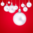 Stock Photo: Christmas balls hanging with ribbons on abstract background