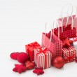 Gift boxes with xmas presents wrapped in red paper with ornament — Stock Photo #14602865