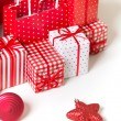 Royalty-Free Stock Photo: Gift boxes with xmas presents wrapped in red paper with ornament