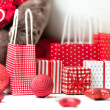 Gift boxes with xmas presents wrapped in red paper with ornament — Stock Photo #14602821