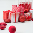 Gift boxes with xmas presents wrapped in red paper with ornament — Lizenzfreies Foto
