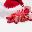 Gift boxes with xmas presents wrapped in red paper with ornament — Stock Photo #14604151
