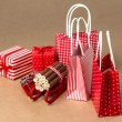 Christmas background with red and natural decorations, gift boxe — Stock Photo #14606269