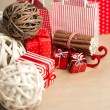 Christmas background with red and natural decorations, gift boxe — Stock Photo #14606409