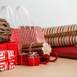 Christmas background with red and natural decorations, gift boxe — Stock Photo #14606459