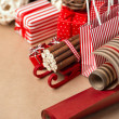 Christmas background with red and natural decorations, gift boxe — Stock Photo #14606643