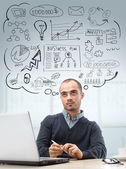 Young business man sitting at office looking up and planning. Gr — Stock Photo