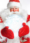 Traditional Santa Claus holding magic snowball Isolated on white — Stock Photo