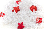 Red christmas decoration on a white tinsel — Stock Photo