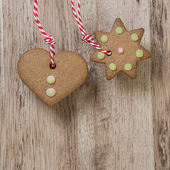 Christmas homemade gingerbread cookies over wooden table — Stock Photo