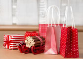 Christmas background with red and natural decorations, gift boxe — Stock Photo