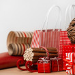 Christmas background with red and natural decorations, gift boxe — Stock Photo #14975939