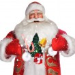 Laughing Santa Claus standing on white backgound and doing magic - Stock Photo