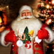 Laughing Santa Claus standing at home near fireplace and Christm — Stock Photo