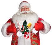 Noel baba beyaz artalan üzerinde duran ve sihir yapıyorsun gülüyor — Stok fotoğraf