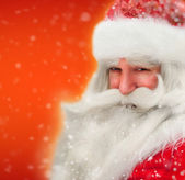 Santa Claus portrait smiling in snowfall — Stock Photo