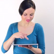 Woman using digital tablet - Stockfoto