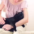 Woman cuddling a cat — Stock Video #15645155