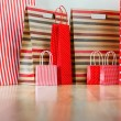 Assorted shopping and gift red paper bags - shopping and holiday — Stock Photo #16018319