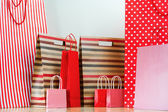 Assorted shopping and gift red paper bags - shopping and holiday — Stock Photo