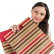 Pretty young woman holding shopping bags isolated on white backg — Stock Photo #16220207