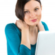 Portrait of young woman dreaming in front of laptop — Stock Photo #16220289