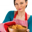 Young pretty woman holdin tasty fresh oatmeal cookies. - Foto Stock