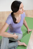 Portrait of healthy young lady practicing yoga exercise - Spine — Stock Photo