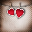 Photo: Valentine background: two hearts hanging on clothespin. Couple c